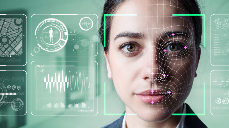 A woman's face is analyzed by facial recognition software.