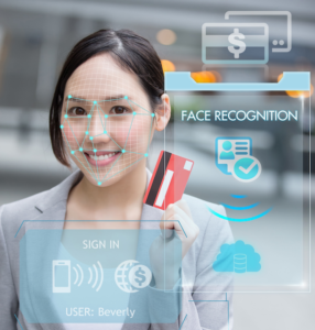 A woman shopper's face is measured by liveness technology.